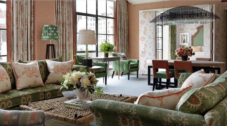 Crosby Street Hotel living room with orange and green color combination decor