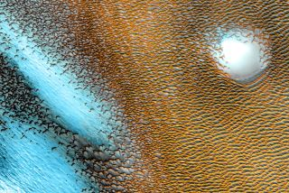 The north pole of Mars glows blue and gold in this false-color heat map.