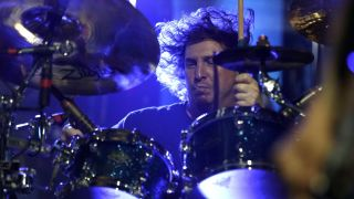 Deftones' Abe Cunningham performing on stage in Köln, Germany