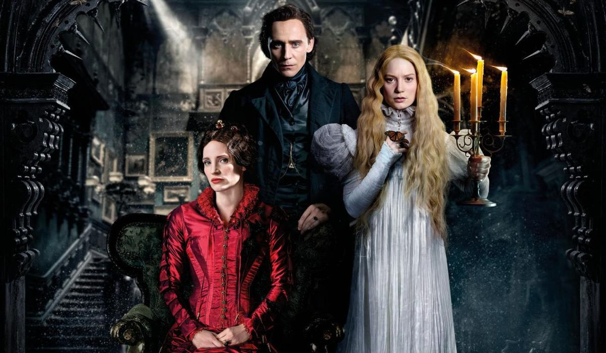 Jessica Chastain, Tom Hiddleston, and Mia Wasikowska stand for a creepy family portrait in Crimson Peak.