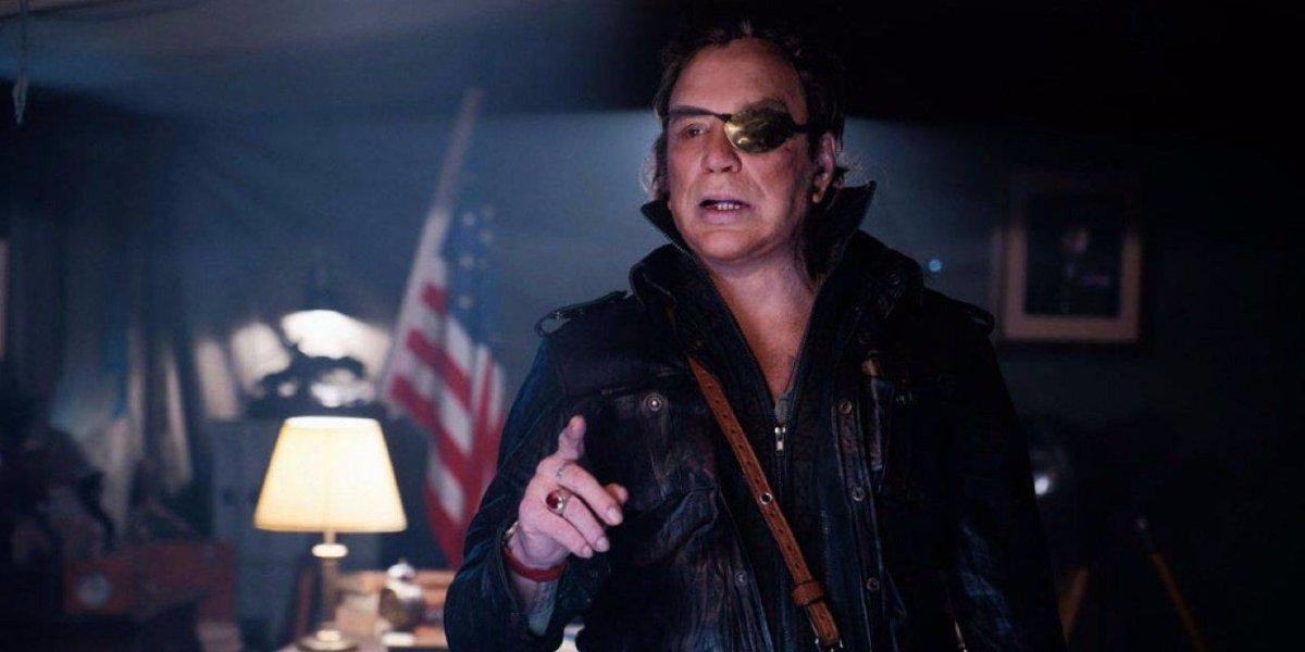 Warhunt Mickey Rourke in a dimly lit office, wearing an eyepatch