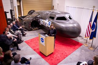 NASA Deputy Administrator Lori Garver talks during a press conference with Sierra Nevada's Dream Chaser spacecraft in the background on Saturday, Feb. 5, 2011, at the University of Colorado at Boulder. Sierra Nevada's Dream Chaser spacecraft is under deve