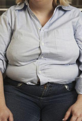 Obese woman in sloppy clothes.