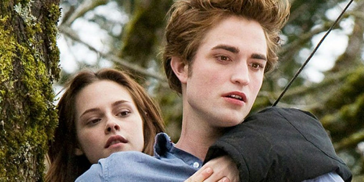 Bella (Kristen Stewart) clings to Edward (Robert Pattinson) in 'Twilight'