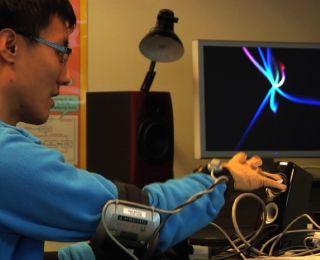 Graduate Student Johnty Wang demonstrates the gesture control system.