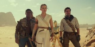 Star Wars: The Rise of Skywalker Finn, Rey, C-3Po, and Poe stand on a ridge in the desert