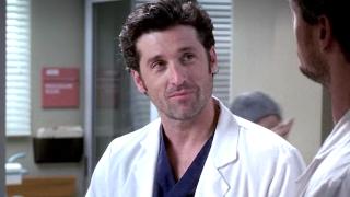 Grey's Anatomy Derek Shepherd smiles slightly at McSteamy.