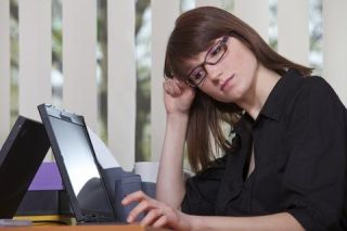Woman at computer, unhappy