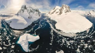This iceberg-filled passage, Lemaire Channel, lies in the Southern Ocean.