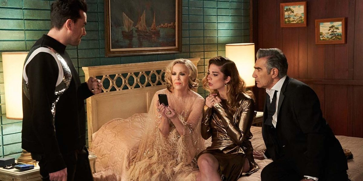 The cast of the Rose family in their hotel room on Schitt's Creek.