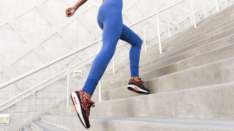 Why you should never diet and exercise at the same time: woman running up stairs