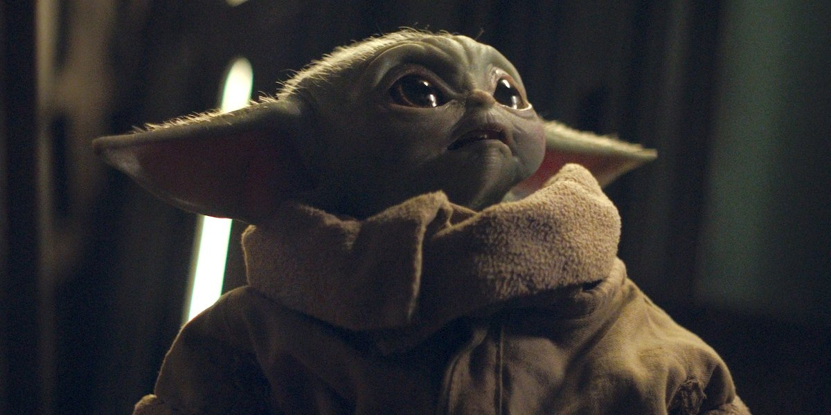 baby yoda looking surprised the mandalorian