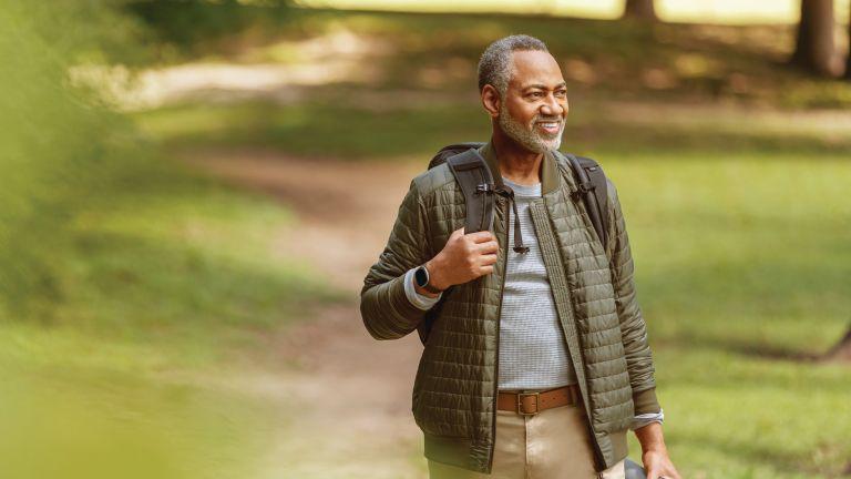 Man walking with Fitbit Sense