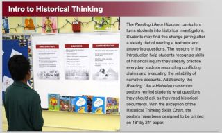 Woman looks at display illustrating principles of historical research
