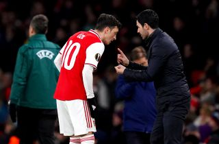 Mikel Arteta insists Mesut Ozil has missed out on a place in Arsenal's Premier League squad based purely on football decisions.