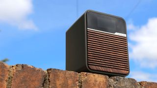 the Ruark Audio R1 Mk4 DAB radio on a brick wall