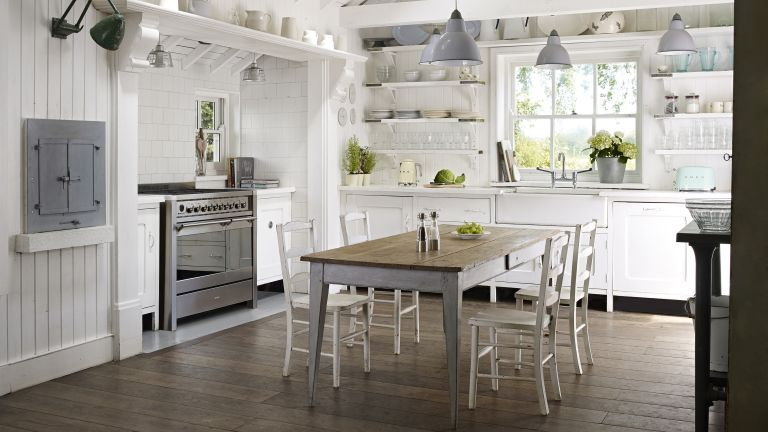 White kitchen with white shelving and industrial style lights