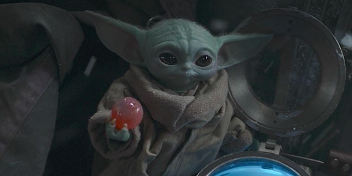 baby yoda holding egg