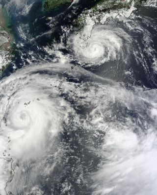 Typhoon Saola and Typhoon Damrey together in a satellite image