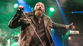 A picture of former Iron Maiden frontman Paul Di'Anno performing on stage