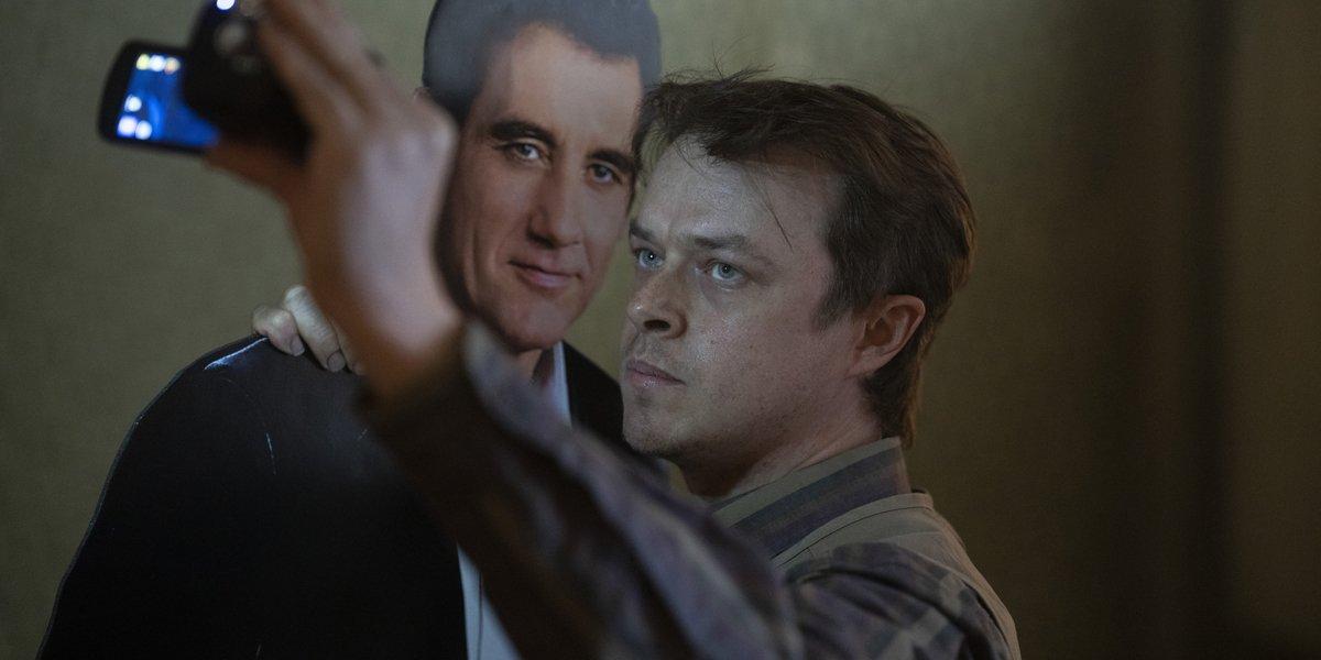 Lisey's Story Jim Dooley taking a selfie with Scott Landon standee Dane DeHaan