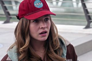 "Actress Britt Robertson, as Casey Newton in Disney's new movie ""Tomorrowland,"" sports a hat displaying NASA's logo."