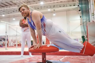 Rob Beckett flexes his muscles as he gives gymnastics a go.