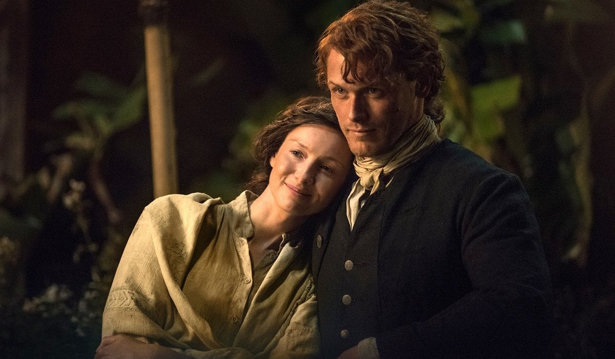 Outlander season 3 Jamie and Claire stand next to each other in the woods