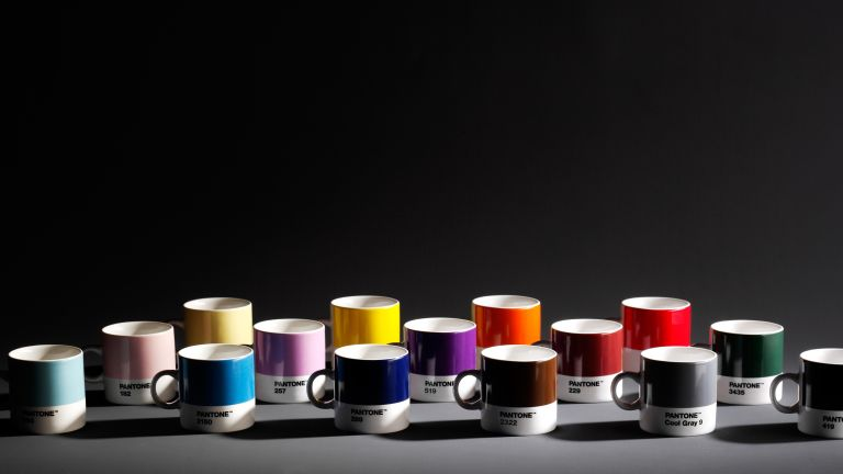 Collection of colourful Pantone mugs