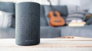 Amazon Echo with guitar in background