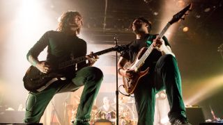 Periphery guitarists Mark Holcomb and Misha Mansoor perform live