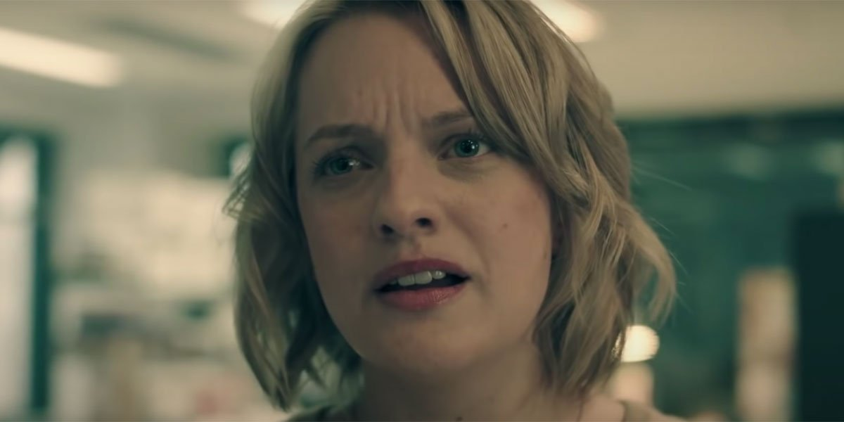 Elisabeth Moss looking shocked during a picture from the Season 1 trailer of Handmaid's Tale.