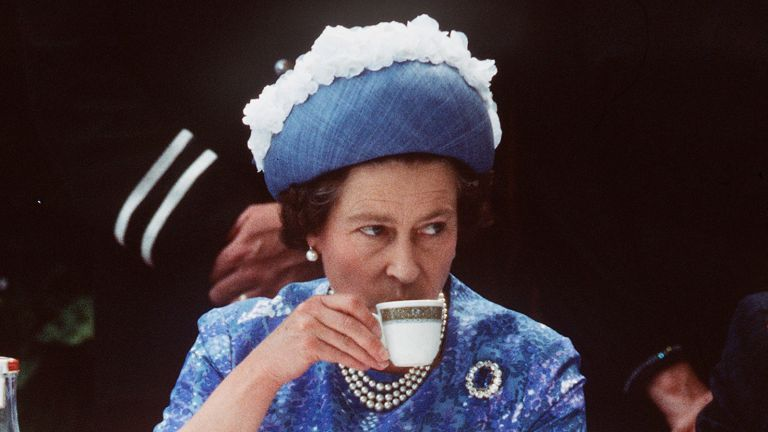 Camilla Parker Bowles's son Tom has shared the secret to making the Queen a perfect cup of tea. NORTHERN IRELAND - 1977: Queen Elizabeth ll has a cup of tea while in Northern Ireland on a royal visit in 1977.(Photo by Anwar Hussein/Getty Images)