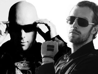 Joe Satriani and Chris Martin take each other on