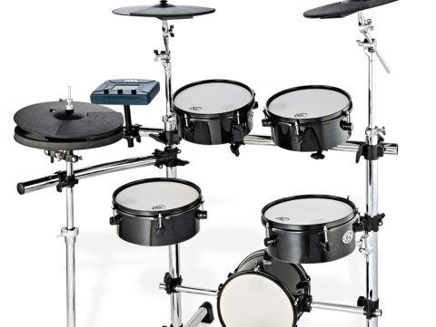 the xm uses mini drum shells for the kit's mesh head pads.