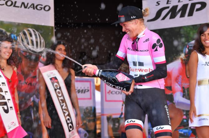 Ellen van Dijk celebrates on the podium after the opening team time trial at the Giro Rosa
