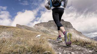 a trail runner on a hillside