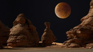 This composite image shows a blood moon lunar eclipse as seen in London and the Acacus mountains in the Libyan desert.