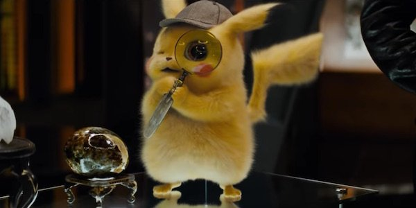 Pikachu holding magnifying glass