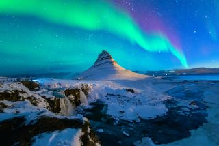 The Northern Lights over Mount Kirkjufell in Iceland