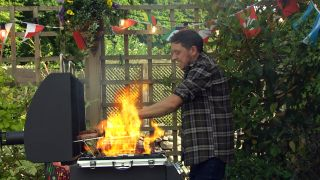 Matty Barton's hands are swallowed up by a fireball as he tends to Marlon's BBQ at the Woolie.