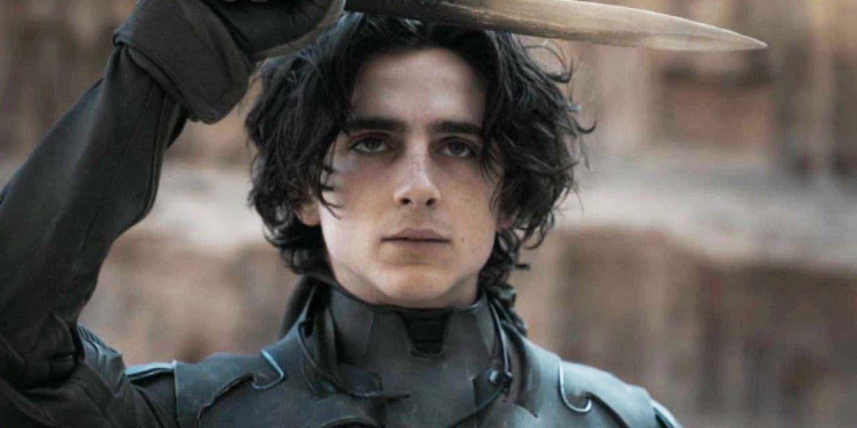 Timothée Chalamet as Paul Atreides in Dune holding up a knife