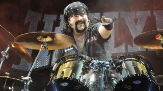 Vinnie Paul, having a ball, with Hellyeah, 2014