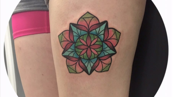 Stained glass mandala tattoo