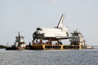 Space shuttle replica Explorer takes barge to Houston.