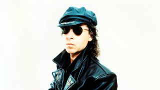 Scorpions singer Klaus Meine wearing a leather jacket and cap