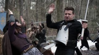 Jeremy Renner as Clint Barton/Hawkeye, sword fighting at a Renaissance Faire in the Hawkeye show