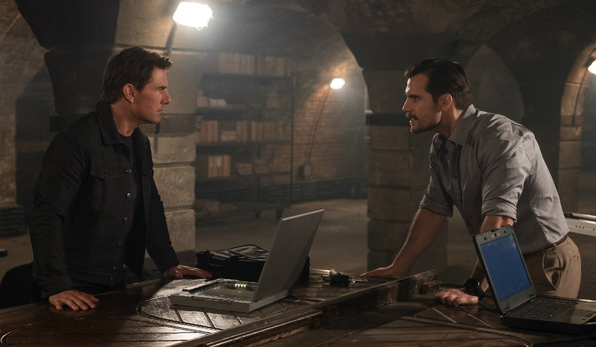 Tom Cruise and Henry Cavill argue over a table of laptops in Mission: Impossible - Fallout.