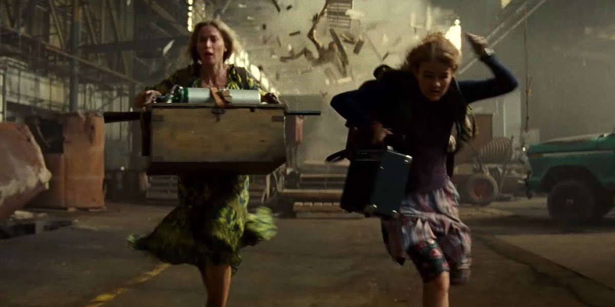 Emily Blunt and Millicent Simmonds in quiet place disaster scene