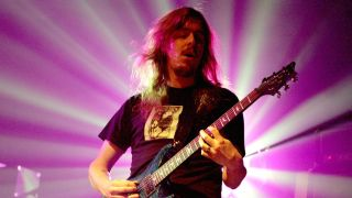 Opeth's Mikael Akerfeldt playing guitar